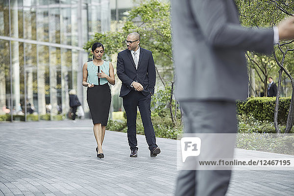 Businesspeople walking together at business park