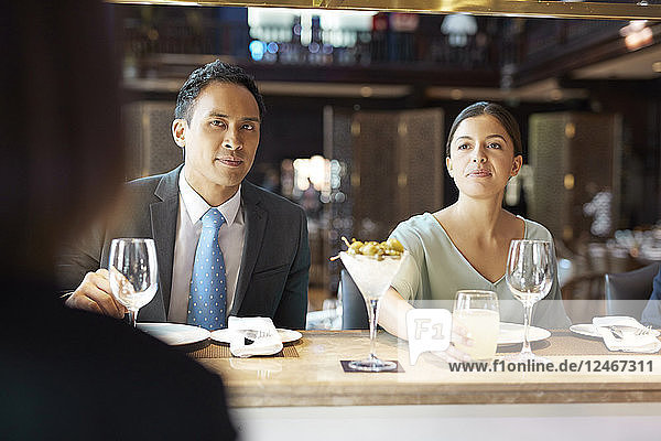 Businesspeople at bar of restaurant