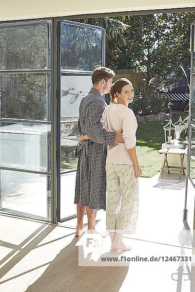 Mid adult married couple standing together.