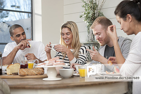 Friends eating breakfast together