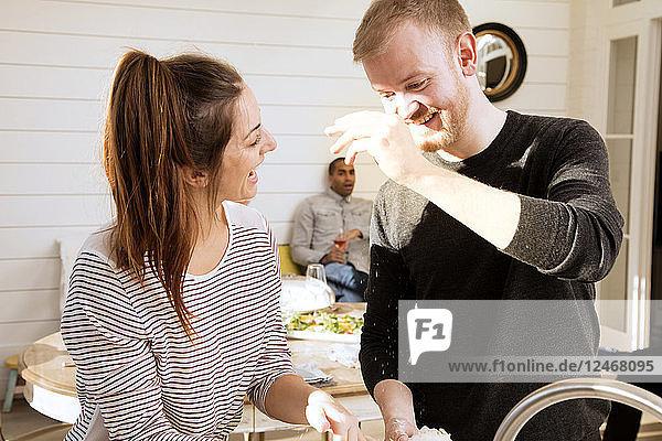 Couple preparing food together