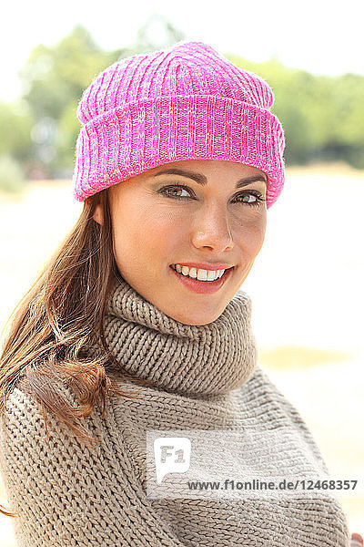 Portrait of young woman in woolly hat