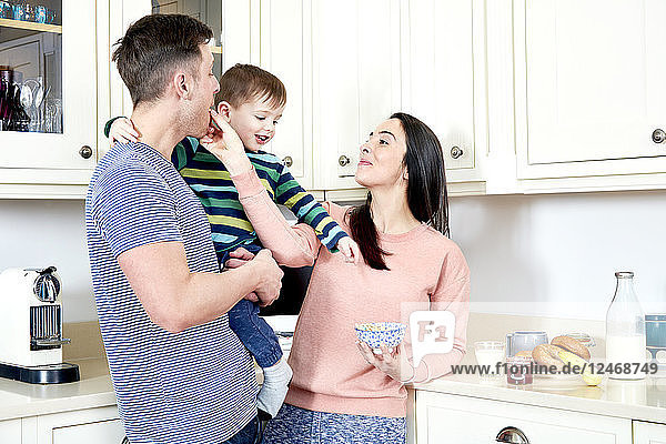 Parents with son in kitchen