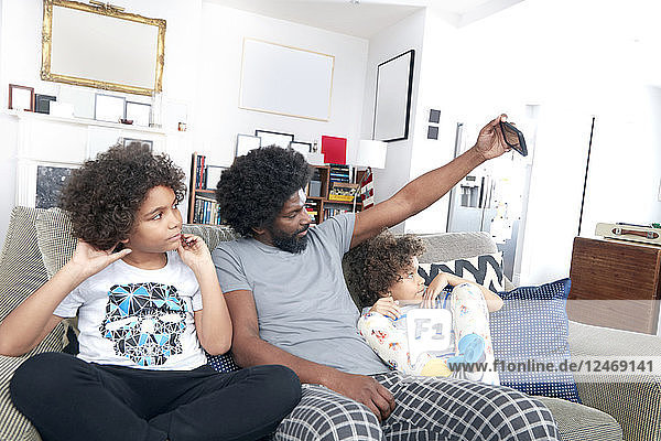 Father taking selfie with children
