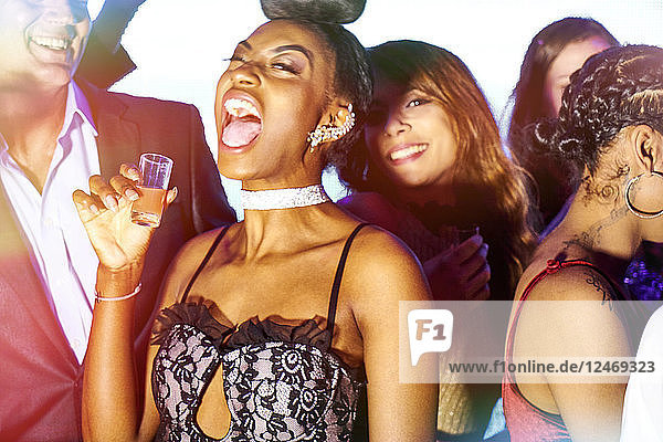 Young woman drinking at nightclub