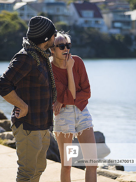 Couple spending time together by lake