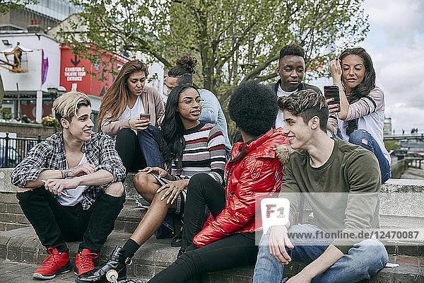 Teenage friends sitting on steps