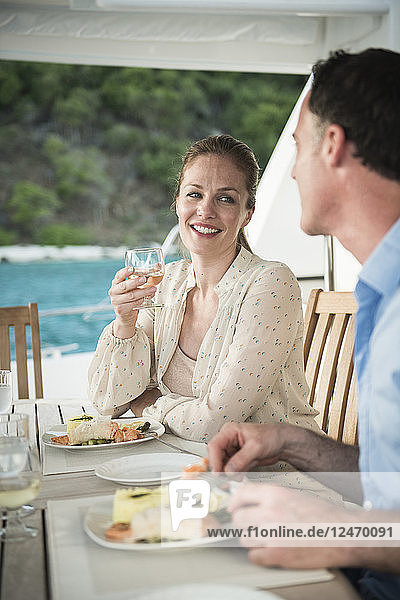 Couple dining on yacht