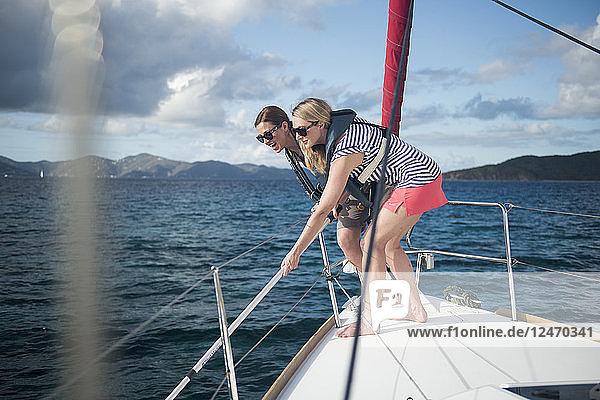 Women wearing life jackets on yacht