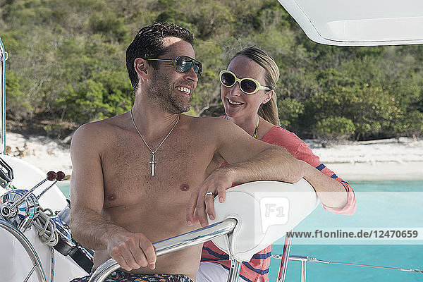 Couple sitting at helm of boat