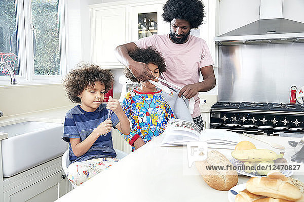 Father and sons in kitchen