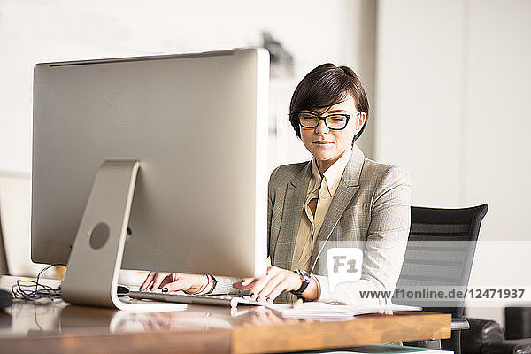 Businesswoman working on computer at desk