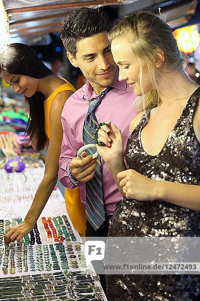 Young couple shopping for bracelets