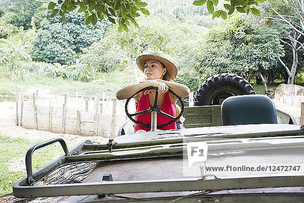 Young woman driving all terrain vehicle in Ko Samui  Thailand
