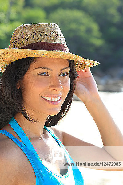 Portrait of young woman wearing straw hat