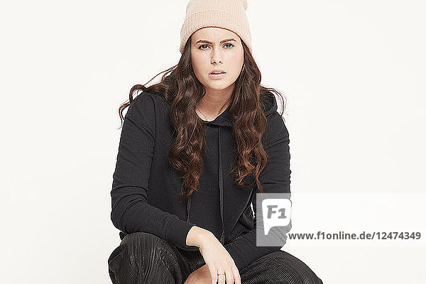 Young woman wearing beanie and black sweater