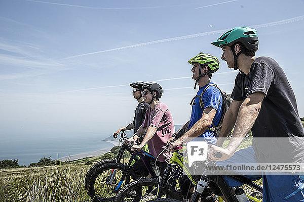 Four men on mountain bikes in Porlock Weir  England