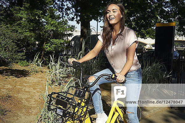 Young woman riding bicycle