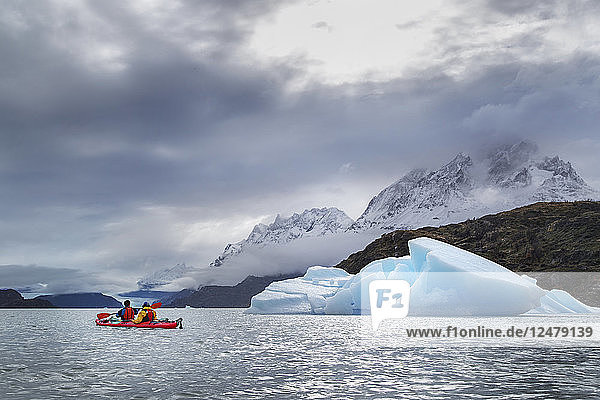 People kayaking by ice berg on Grey Lake in Torres del Paine National Park  Chile