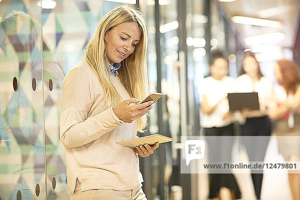 Young businesswoman using smart phone