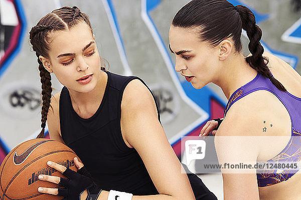 Young women playing basketball