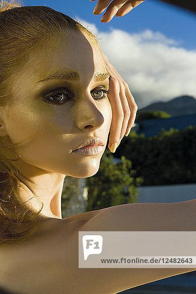 Portrait of young woman wearing eyeshadow