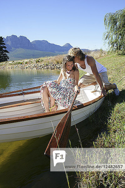 Young couple in row boat
