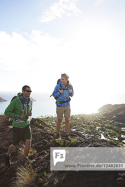 Young couple hiking on mountain