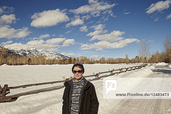 Woman on snowy rural road