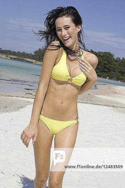 Young woman in yellow bikini on beach