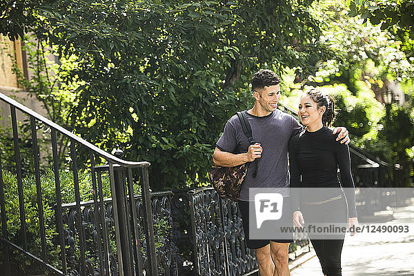 Couple Walking Home After Workout