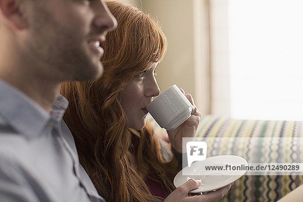A lovely young couple enjoys coffee.