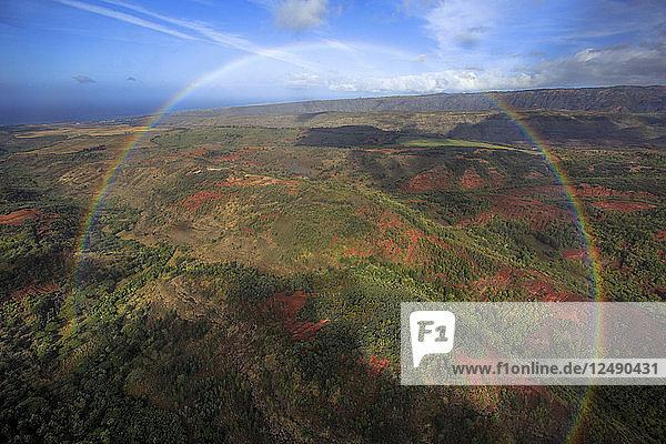 A Full Circle Rainbow Hovers Over The Hawaiian Landscape