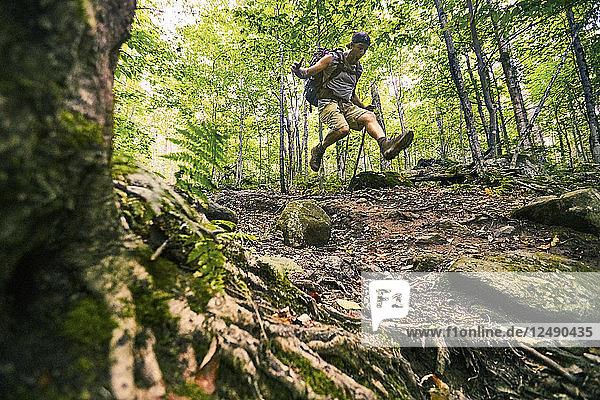 A Man Jumping While Hiking At Appalachian Trail