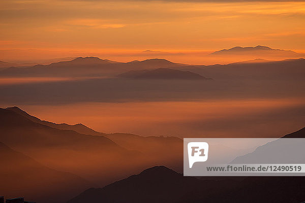 Foggy Mountain During Sunset In La Parva  Chile