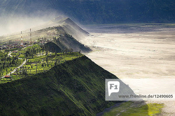 Volcanic dust blows over the small village of Cemoro Lawang perched on the edge of the Tengger caldera.