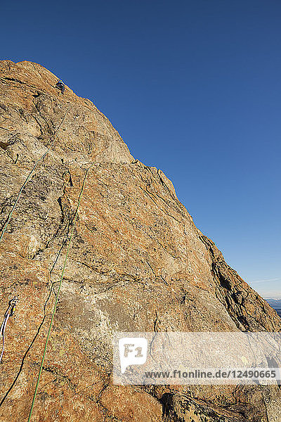 Female climber climbing pitch 2 on Reka mountain peak  Vester?•len  Norway
