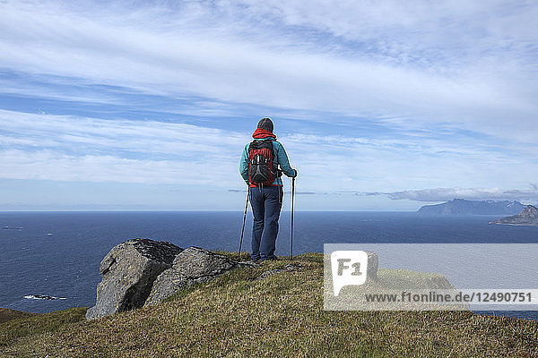 Female hiker with view over sea from Ytresandheia  Moskenes??y  Lofoten Islands  Norway