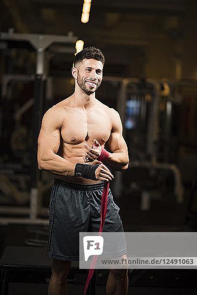 Man training at indoor gym