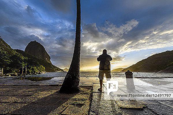 Photographer Shooting The Sunrise In Praia Vermelha  Rio De Janeiro  Brazil
