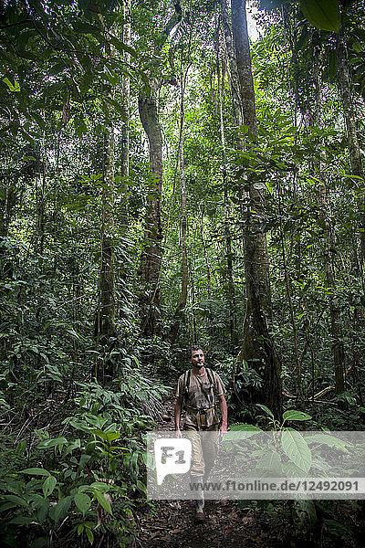 A man walks through Peru's Amazon Jungle.