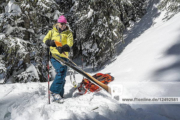 A woman backcountry skiing in Deer Creek  San Juan National Forest  Durango  Colorado.