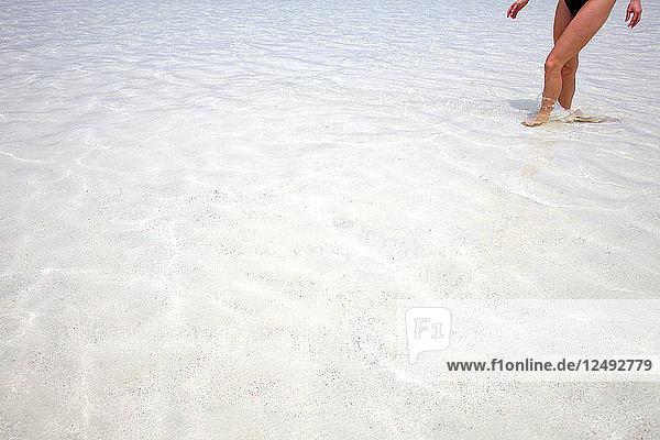 A girl walking in Punta Cana Beach  Dominican Republic
