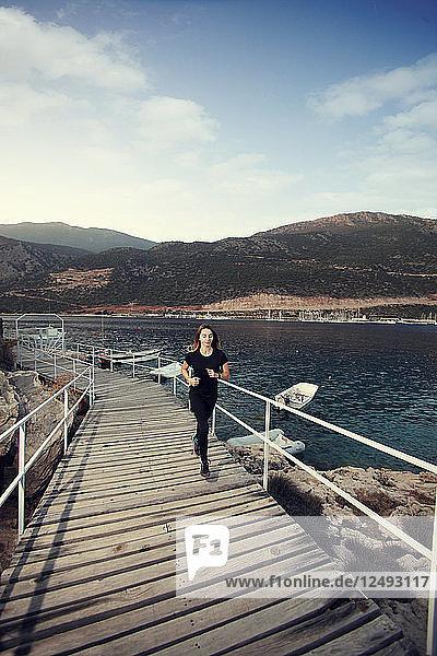 Woman running on the bridge at the seaside  Antalya Ka?ü Turkey