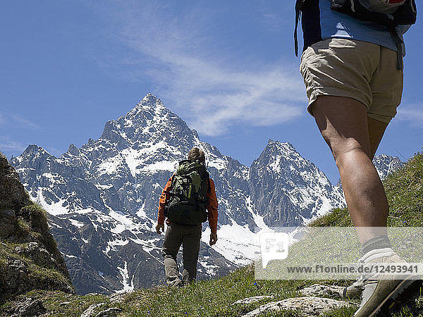 Low angle view of climbers heading towards mountain