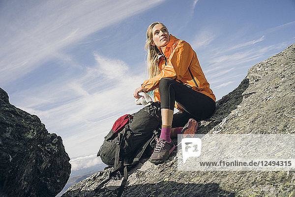 Woman Relaxing On Rock In Mount Mansfield  Vermont