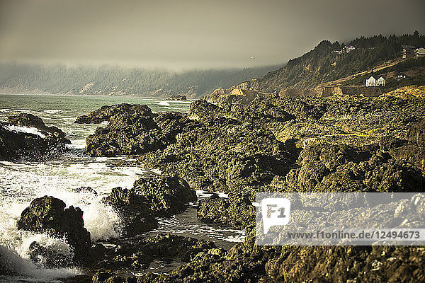 Waves crash on the rocky coast of Shelter Cove  California.