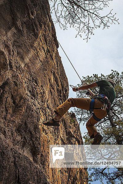 Man Rappels On Rock Near Flagstaff  Arizona