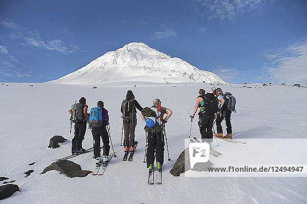 Group Of Skier Standing On Snow In Mount Saint Augustine Volcano  Alaska  Usa