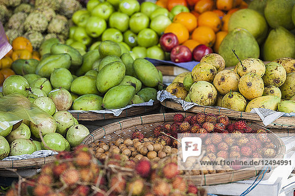 Variety Of Fruits In Basket For Sale At Street Market In Hoi An